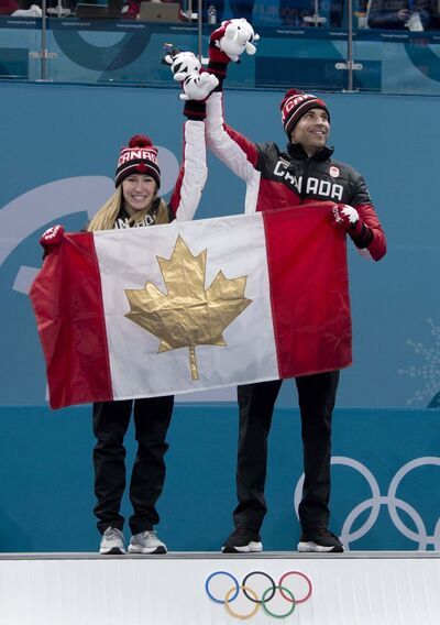 With the win, Lawes and Morris became the first ever curlers from Canada to win two gold medals. (Michael Burns / The Canadian Press)</p>