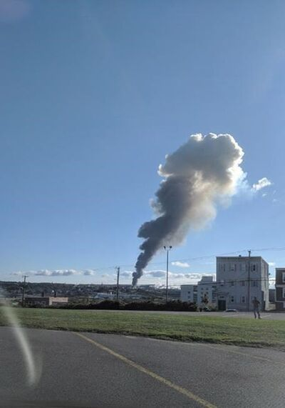"A plume of smoke rises from an Irving Oil refinery in the distance following reports of an explosion in Saint John, N.B., on Monday, October 8, 2018. Irving Oil says a ""major incident"" happened at its oil refinery in Saint John, N.B., this morning. THE CANADIAN PRESS/HO - Michael Steeves"