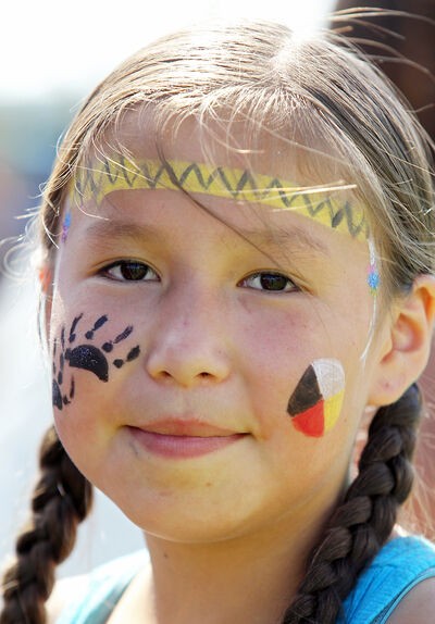 Colourful face paint adorns Alora Bunn as she participates in National Aboriginal Day festivities at École New Era School on Saturday.