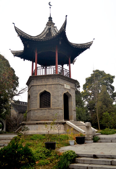 This is the Pavilion of Wang Yue. A small lookout post where people can see out over the gardens but not high enough to see over the wall. It is plain and unadorned to keep with the solemn feel of this place.