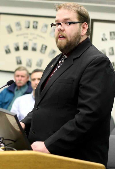 Shaun Cameron, chair of Renaissance Brandon, addresses city council at city hall on Monday evening.