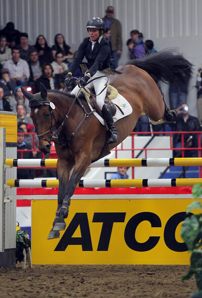 Karen Cudmore easily clears the ATCO marquee jump with Shea to win the evening event at the Royal  Manitoba Winter Fair on Thursday.