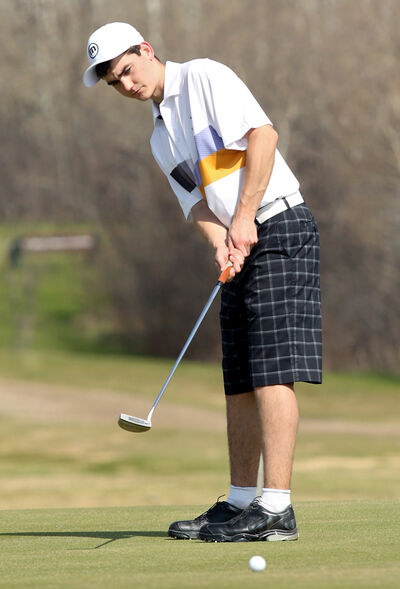 Carberry's Joel Baron sinks a putt on Saturday at Shilo.