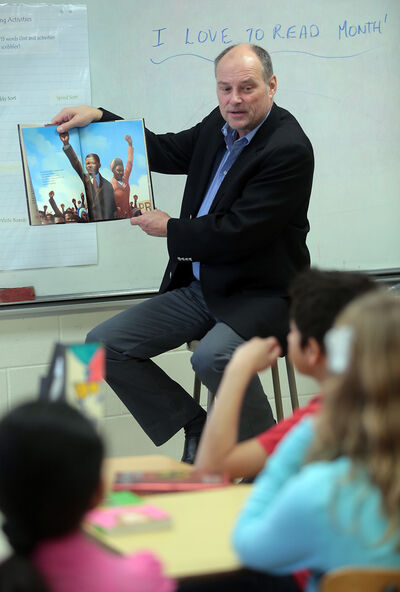A King George School classroom was visited by Brandon East NDP MLA Drew Caldwell, who read from an age-appropriate biography of Nelson Mandela as part of I Love to Read Month.