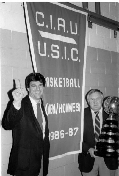 George Birger, right, and Jerry Hemmings pose with the CIAU championship banner and trophy in 1987, Birger's final season at Brandon University.