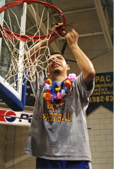 Charlton Weasel Head cuts the net at BU after capturing the 2001 GPAC men's basketball title.