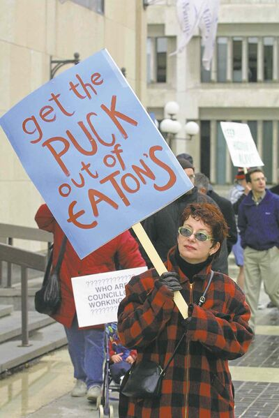 People protest the demolition of the  old Eaton's building on May 23, 2001.
