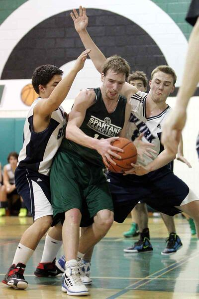 Theo Farough of the Neelin Spartans tries to move the ball during Brandon Sun Spartans Invitational tournament action against the Selkirk Royals at the Neelin gym on Saturday night.