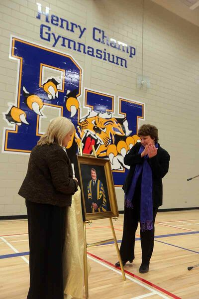 Brandon University president Deborah Poff, left, and Karen DeYoung, wife of the late Henry Champ, unveil a portrait of the former chancellor in the newly named Henry Champ Gymnasium on Thursday afternoon.