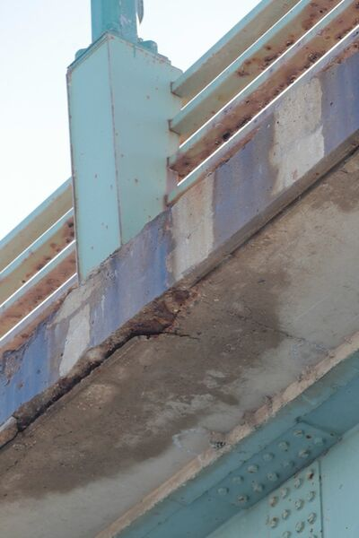 Brandon Sun Eroded concrete on edge of the bridge deck is visible running the length of the First Bridge on Thursday afternoon.