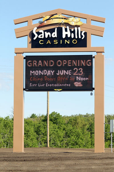 The sign outside the Sand Hills Casino on Highway 5 south of Carberry advertises today's grand opening on Saturday.