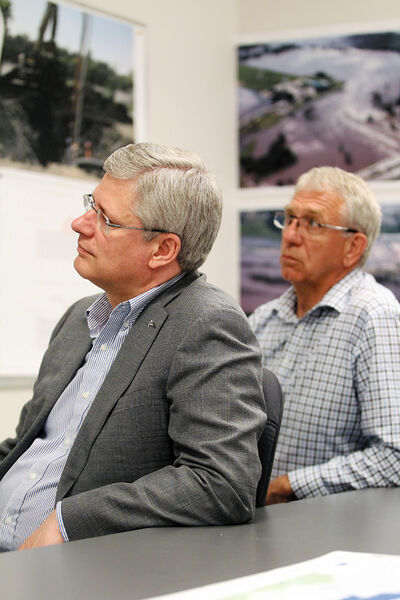 Prime Minister Stephen Harper and Brandon-Souris Conservative MP Larry Maguire listen to a flood briefing at Brandon City Hall on Sunday. Harper was in Brandon on Sunday to tour floodwaters from the air in a helicopter.