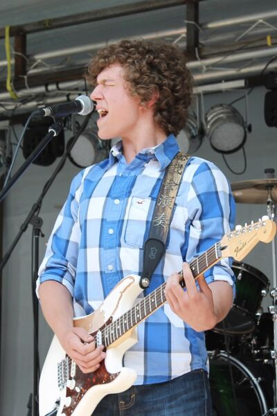 Quinn Johner performed with his dad and brothers on Saturday afternoon at Delodaze.