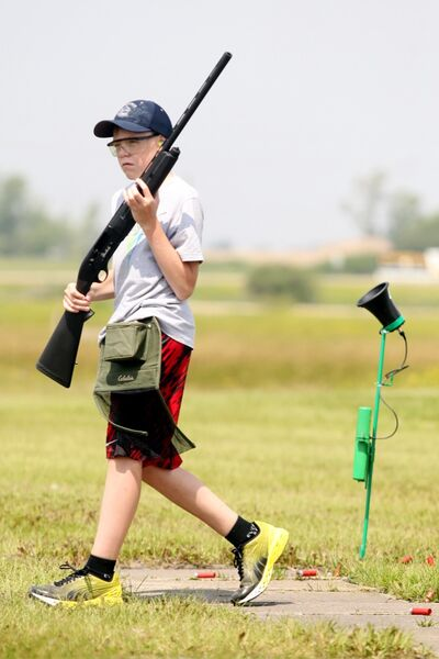 Chris Piche holds up his shotgun during a break in competition at the Provincial junior trapshooting championships at the Brandon Gun Clun on Saturday afternoon.