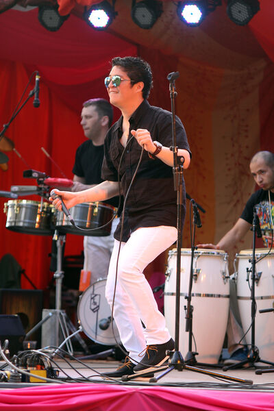 Carlos Ecos of local band Son Latino busts a move on the festival stage Sunday.