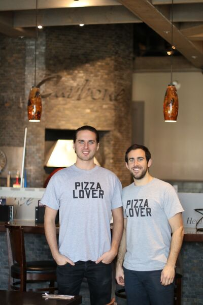 Fast Fired by Carbone owners Benjamin Nasberg, left, and Joe Palette, from left, are seen at one of their four Carbone's Coal Fired Pizza locations in Winnipeg. The duo are opening a pizza joint at Brandon's Corral Centre within the next couple weeks.