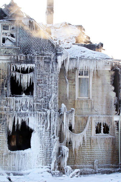 Icicles cling to the outside of a large house converted to suites at the corner of Fourth Street and Louise Avenue on Wednesday morning, the day after the building went up in flames in a suspected arson. Firefighters fought the fire that began Tuesday afternoon well into overnight Wednesday and continued to pour water on the home Wednesday morning. (Tim Smith/The Brandon Sun)
