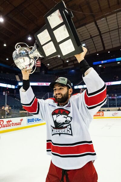 Former Brandon Wheat Kings captain Stelio Mattheos of Winnipeg hoists the Calder Cup after the Charlotte Checkers beat the Chicago Wolves in five games in the American Hockey League final.