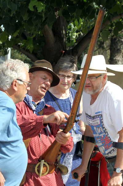 Chuck Vidnes explains how the flint-lock mechanism works at the Manitoba Muzzleloader's Association venue during the festival.