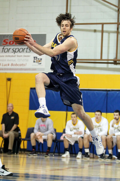 Alex Klocek of the Brandon Bobcats catches a pass from a teammate before taking a shot during Saturday's game against the Regina Cougars at the BU gymnasium.