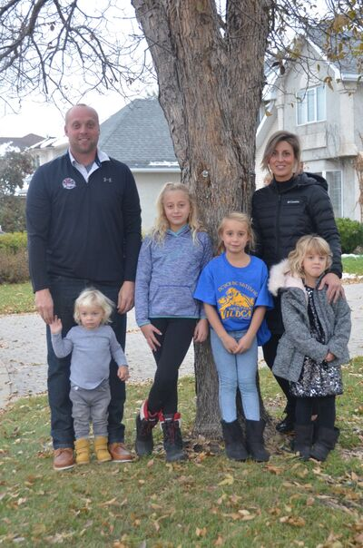 Former Brandon Wheat Kings goaltender Jamie Hodson and his wife Lindsey pose with their four children in a recent family picture.