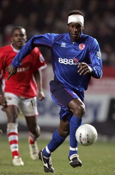 FILE - In this Thursday March 23, 2006 file photo, Middlesbrough's Ugo Ehiogu controls the ball during the English FA Cup sixth round soccer match against Charlton Athletic at the Valley stadium, London. Ugo Ehiogu, the former England defender who was a coach of Tottenham's under-23 team, died Friday April 21, 2017, after suffering a cardiac arrest. He was 44. (AP Photo/Tom Hevezi, File)