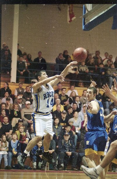 Charlton Weasel Head throws a pass at Brandon University during his second year with the Bobcats in 2000-01. (Brandon Sun file)