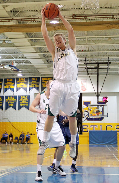 Brandonite Sterling Nostedt of the Regina Cougars hauls down a rebound Saturday night at the BUgym.