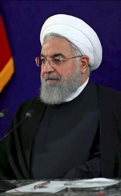 "In this photo released by an official website of the office of the Iranian Presidency, President Hassan Rouhani attends a meeting with officials and industrialists, at a petroleum conference in Tehran, Iran, Tuesday, May 8, 2018. Iran's president on Tuesday warned the country could face ""some problems"" ahead of President Donald Trump's decision on whether to pull out of its nuclear deal with world powers. (Iranian Presidency Office via AP)"