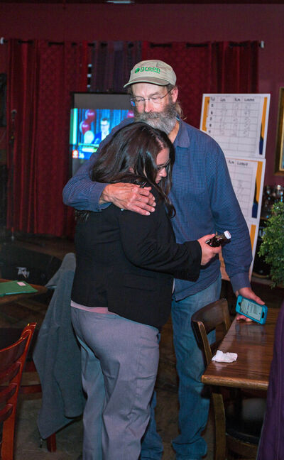 Brandon East NDP candidate Lonnie Patterson hugs supporter Dave Barns at the NDP headquarters at Lady of the Lake Tuesday. (Chelsea Kemp/The Brandon Sun)