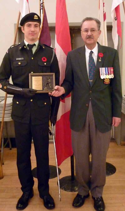 "Cadet Warrant Officer Cole Ramsey, of the XII Manitoba Dragoons Cadet Corps in Virden, was presented with the President's Trophy for being the ""Most Outstanding Manitoba Army Cadet."" Making the presentation was LCOL (Ret'd) Sandy Will, president of the Manitoba branch of the Army Cadet League of Canada."