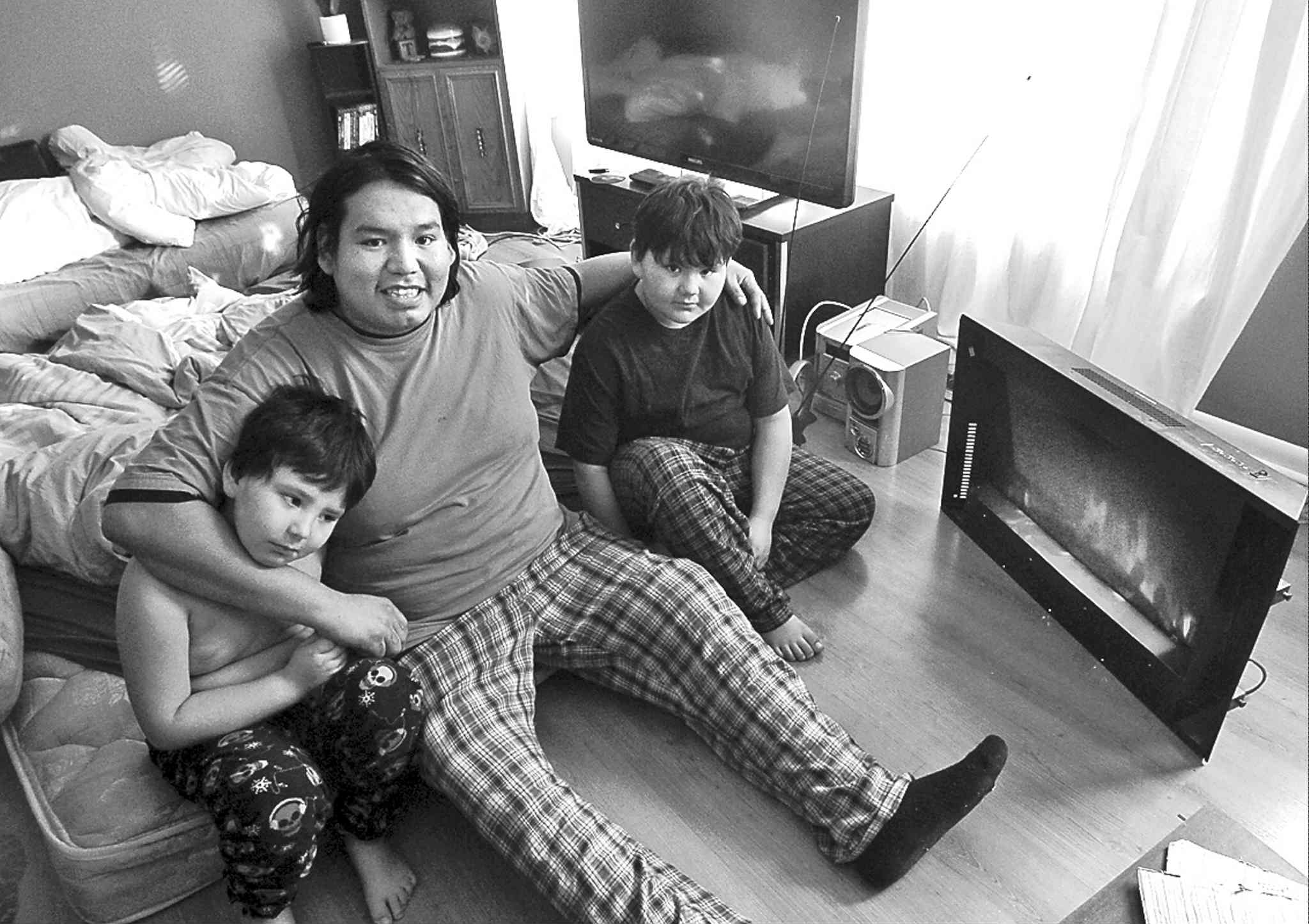 Derek Dowan and his sons, Dave (left) and Daniel, have been having sleepovers in the living room.