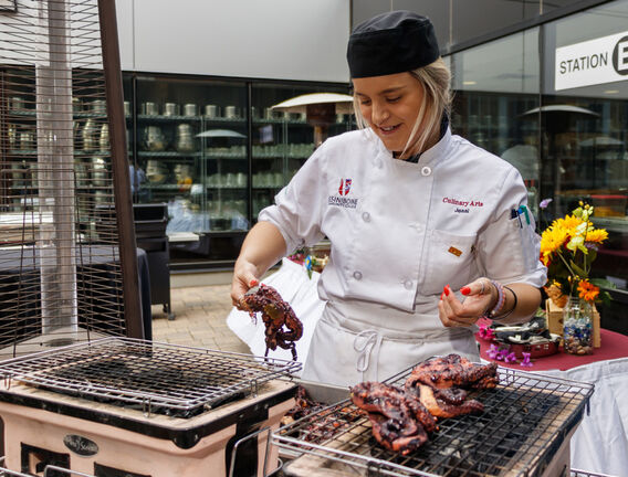 Culinary student Jessi Coulter throws some octopus on the barbecue at Assiniboine Community College. (Chelsea Kemp/The Brandon Sun)