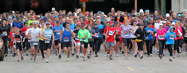Runners in the five- and 10-kilometre competition leave the start line during the Brandon Family YMCA Spring Run on Sunday in downtown Brandon.