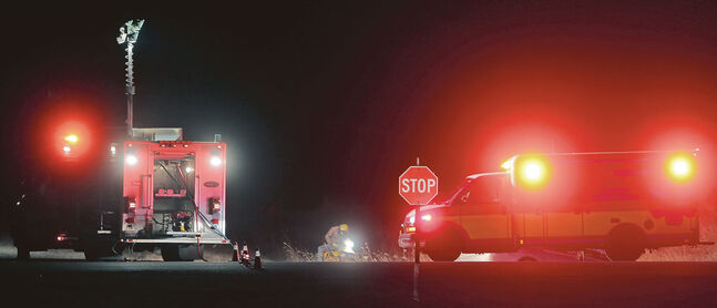 Brandon Sun Emergency crews work at side of the road on Highway 10 and the intersection of Tower Road on Thursday evening. Traffic both north and southbound was stopped as emergency crews worked at the scene of an accident. Few details were available at press time. (Bruce Bumstead/Brandon Sun)
