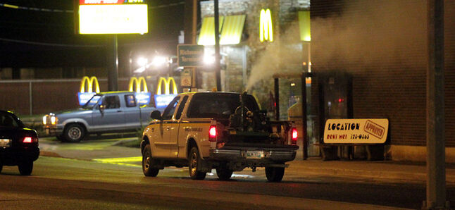 A City of Brandon truck spraying malathion travels along Richmond Avenue in June 2010.
