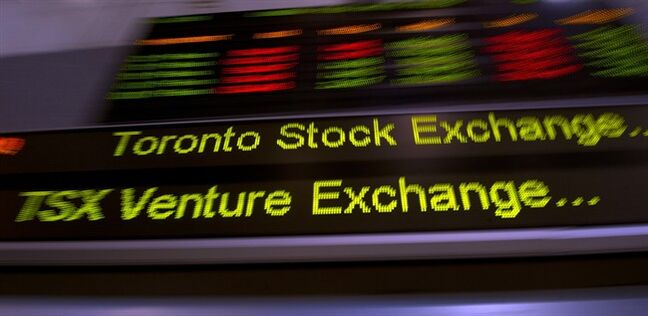 TMX Group tickers zoom across banners in Toronto on May 10, 2013. THE CANADIAN PRESS/Frank Gunn