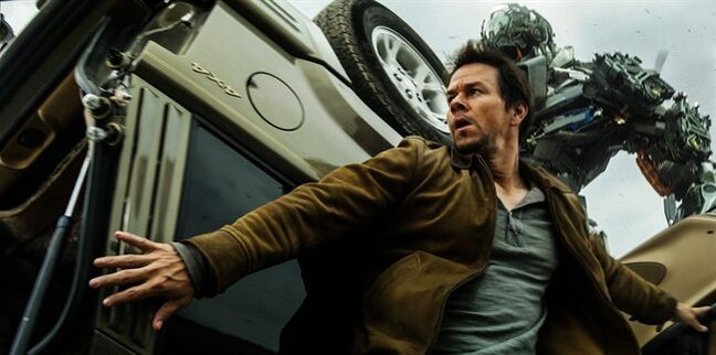 This photo released by Paramount Pictures shows, Mark Wahlberg, front, as Cade Yeager, and Lockdown, rear, in a scene from the the film,