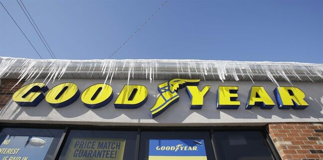 In this Wednesday, Feb. 12, 2014 photo shows icycles hanging above a Goodyear sign in South Euclid, Ohio. Goodyear reports quarterly earnings on Thursday, Feb. 13, 2014. (AP Photo/Tony Dejak)