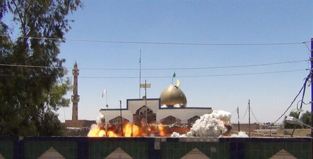 In this undated photo posted on a militant website that frequently carries official statements from the Islamic State extremist group, which has been verified and is consistent with other AP reporting, Shiite's Saad bin Aqeel Husseiniya shrine explodes in Tal Afar, Iraq. Images posted online show that Islamic extremists have destroyed at least 10 ancient shrines and Shiite mosques in territory - the city of Mosul and the town of Tal Afar - they have seized in northern Iraq in recent weeks. (AP Photo)