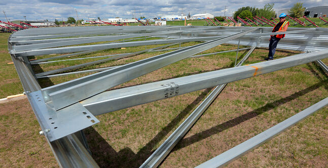 In this June 2013 photo, a large metal truss sits assembled in a field at Behlen Industries as a mock-up for an order that will be sent to Russia.