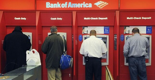 FILE - In this file photo taken Oct. 16, 2009, customers use ATM machines at a Bank of America branch office in Boston. The FDIC reported that the U.S. banking industry earned $37.2 billion in the first quarter of 2014, down from $40.3 billion in the same period in 2013. (AP Photo/Lisa Poole, File)