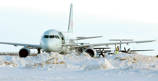 Diverted aircraft wait to be refuelled at the Brandon Municipal Airport on Wednesday as poor weather in Winnipeg led to several flights landing in the Wheat City.