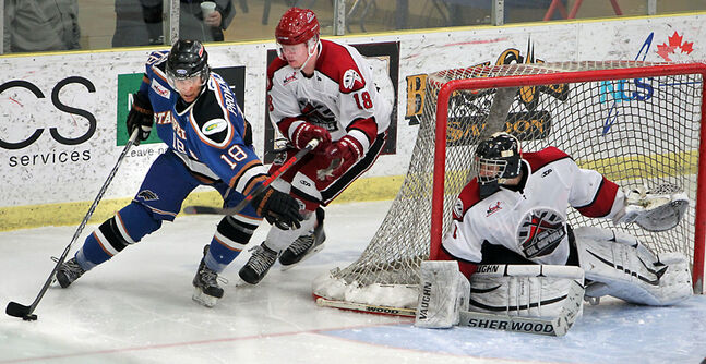 Cole Hamblin and goalie Adam Iwan of the Virden Oil Capitals watch as Max Provencher of the Swan Valley Stampeders swoops around the net during the Oil Capitals' first-ever Manitoba Junior Hockey League playoff game on Saturday night. The Stampeders won 3-0.