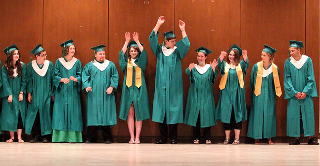 Students do the wave shortly before their entrance during École secondaire Neelin High School's graduation ceremony at the Western Manitoba Centennial Auditorium on Tuesday afternoon.