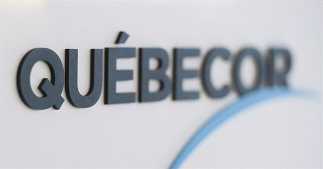 A Quebecor Inc. sign is shown the company's annual general meeting in Montreal, on June 19, 2014. THE CANADIAN PRESS/Graham Hughes