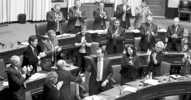 Conservative Leader Hugh McFadyen receives a standing ovation on his last day in the Manitoba legislature during Thursday's session.