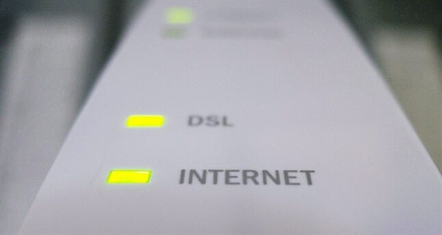 Internet and DSL lights are illuminated on a modem in Chelsea, Que., July 11, 2011. THE CANADIAN PRESS/Adrian Wyld