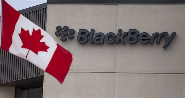 A Canadian flag flies at BlackBerry's headquarters in Waterloo, Ont., Tuesday, July 9, 2013. Blackberry plans to sell most of its Canadian real estate holdings as it works to shore up its business under new management.THE CANADIAN PRESS/Geoff Robins