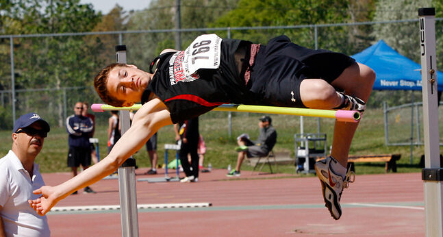 Jordan Devloo from Prairie Mountain High School in Somerset catches the bar as he competes in the senior boys' high jump final at the provincial high school track and field championships at in Winnipeg on Friday.